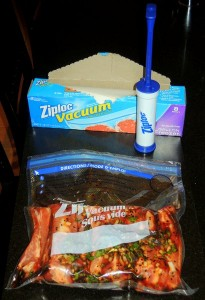 I used the inexpensive Ziploc system. Shown here are pork ribs in a one-gallon bag. The little hand pump is used to remove excess air.